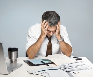 Frustrated Man Worries About Economy, Unpaid Bills and Retiremen